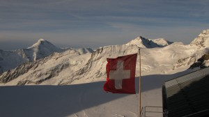 Swiss Flag with Jungfrau in the background